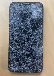 Broken iphone screen showing how glass shatters with many cracks